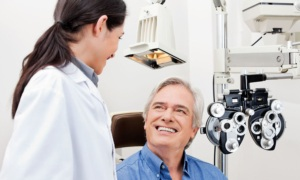 Man consulting with female optometrist